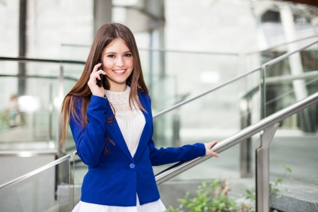 traineeship: Portrait of a young smiling woman talking on the phone Stock Photo