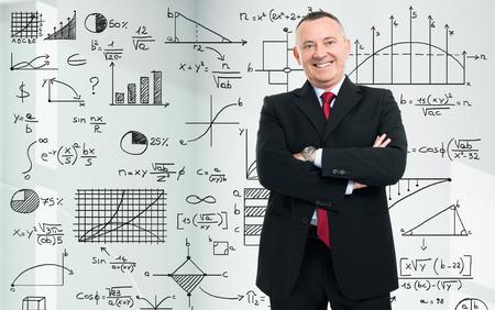 business mind: Businessman in front of math formulas
