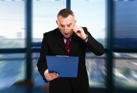 pricey: Shocked businessman reading a document Stock Photo