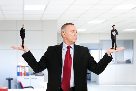 Businessman choosing a new employee for his office