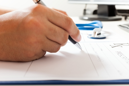 doctor writing: Close-up of a medical prescription