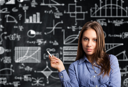 Portrait of a woman in front of a blackboard photo