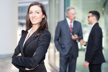traineeship: Woman posing in front of her colleagues