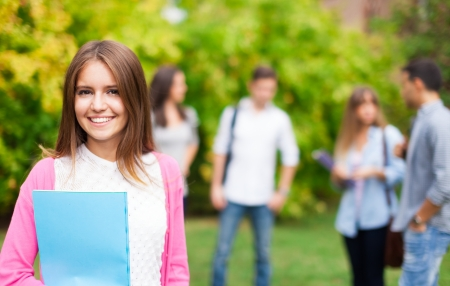 high class: Outdoor portrait of a smiling student
