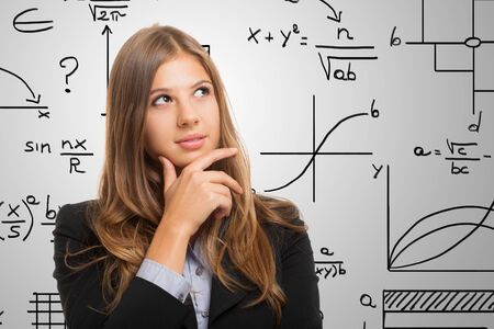 corporate training: Pensive woman resolving a complex problem Stock Photo