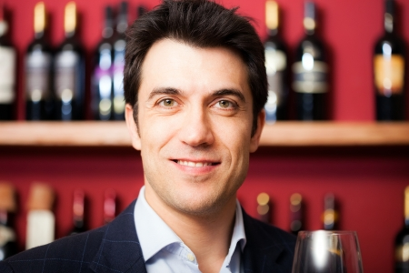 Man satisfied with the quality of the wine that has just tasted photo
