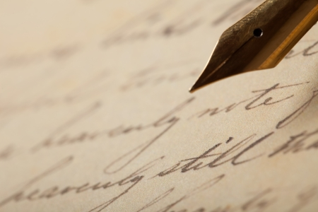 fountain pen writing: Fountain pen on an antique handwritten letter Stock Photo