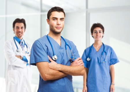 pathologist: Portrait of an handsome doctor in front of his medical team Stock Photo