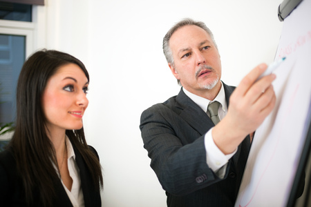 traineeship: Executive giving instructions to an employee