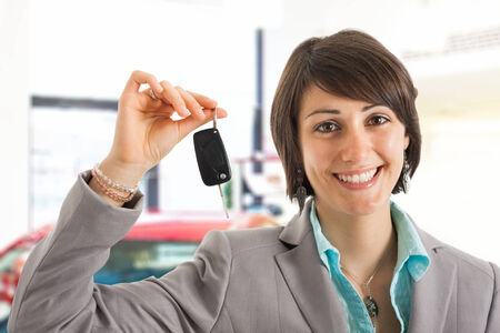 Leasing: Woman driver holding car keys Stock Photo