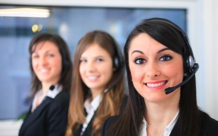 customer care: Portrait of a smiling customer representative at work