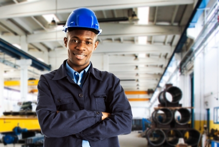 upkeep: Portrait of a young smiling worker Stock Photo
