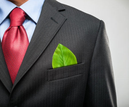 Ecology concept, businessman keeping a green leaf in his pocket Stock Photo