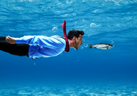 undersea: Funny businessman swimming underwater
