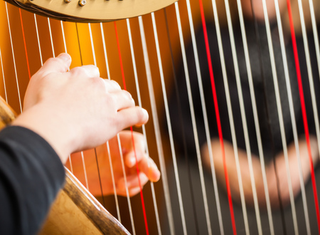 harp: Close-up of a woman playing the harp