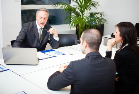 bank manager: Businessman talking to a couple