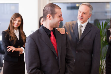 Successful business people in their office Stock Photo