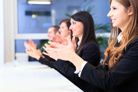 appreciation: Business people applauding during a meeting