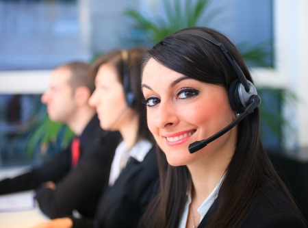 Portrait of a smiling customer representative at work photo