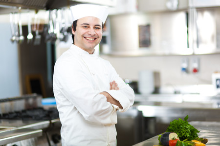 Portrait of a Chef at work in his Kitchen photo