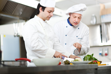 traineeship: Detail of a Chef at work in his Kitchen