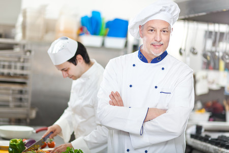 traineeship: Portrait of a Chef at work in his Kitchen