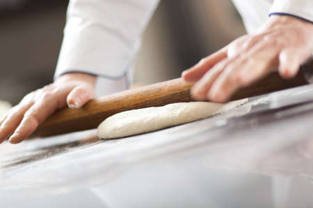 Detail of a Chef at work in his Kitchen photo