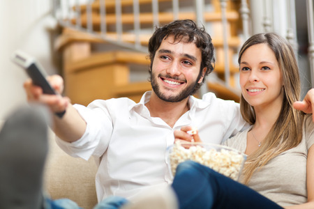 tv home: Couple watching a movie in their house Stock Photo