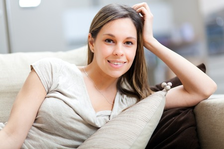 Young woman relaxing on the couch Stock fotó