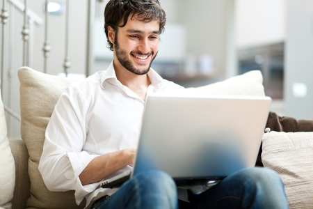 a young man: Young man relaxing on the couch Stock Photo