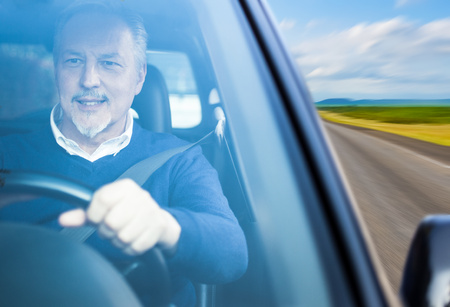 man driving: Portrait of a man driving a car Stock Photo