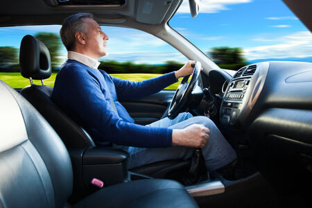 Man driving his car photo