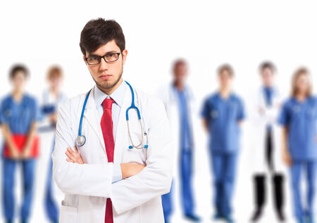 Portrait of a doctor in front of his medical team Stock Photo - 27647518