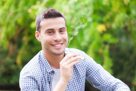 Man smoking an electronic cigarette outdoors Stock Photo