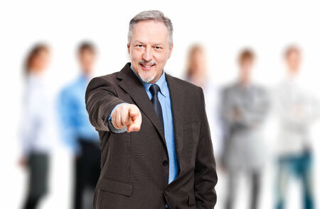 Mature businessman pointing at you photo