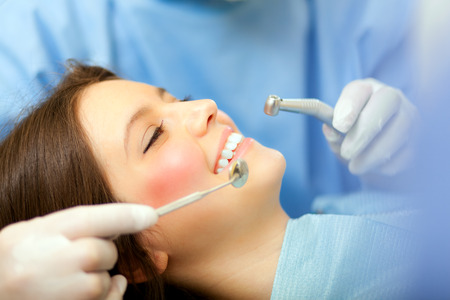 oral surgery: Female patient having a dental treatment