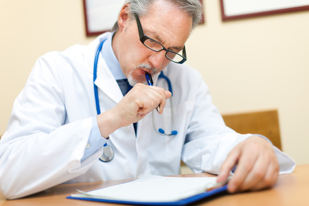 doctor writing: Doctor writing a prescription Stock Photo