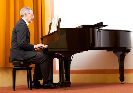 pianist: Man playing piano Stock Photo