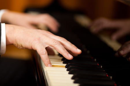 Male hands playing piano photo