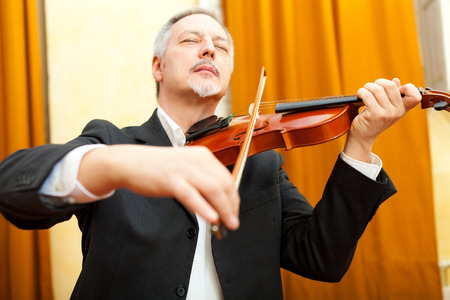 Man playing violin photo
