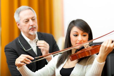 woman violin: Violin lesson Stock Photo