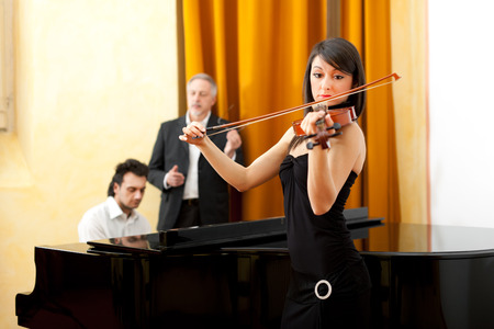 Woman and man playing classic music photo