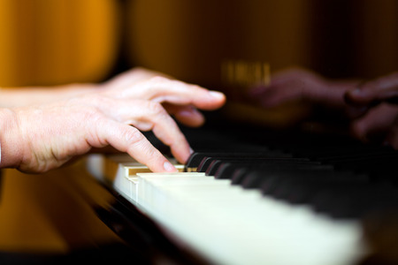 Man playing the piano close up photo