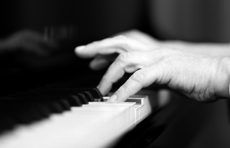 Man playing the piano black and white photo