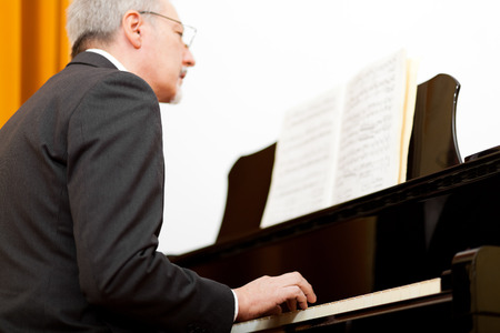 Man playing the piano photo
