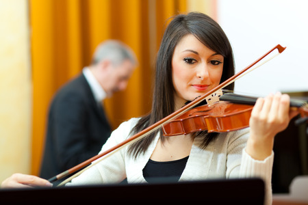 Beautiful woman playing violin photo