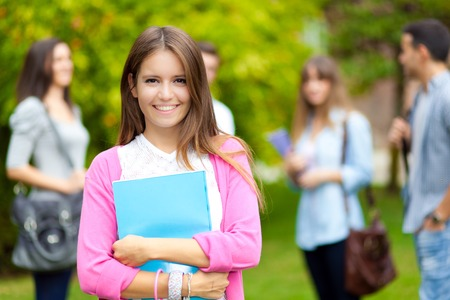 Smiling student outdoor portrait Stock Photo