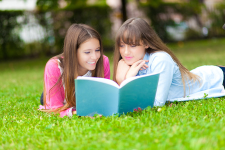 Couple of young female students at the park photo