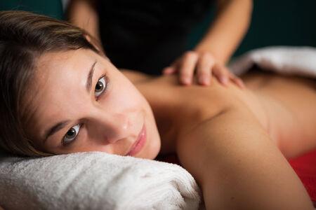 rubdown: Relaxed woman receiving a massage
