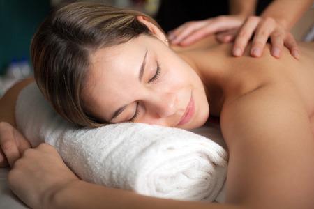 tuina: Beautiful woman having a massage Stock Photo